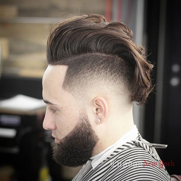 a high fade mohawk is a bold modern option with a movement and flow
