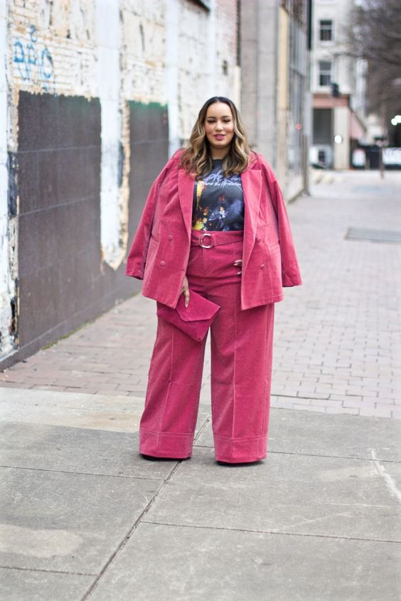 a pink velvet suit will keep you warm and suits are super trendy, add a bright top to your look