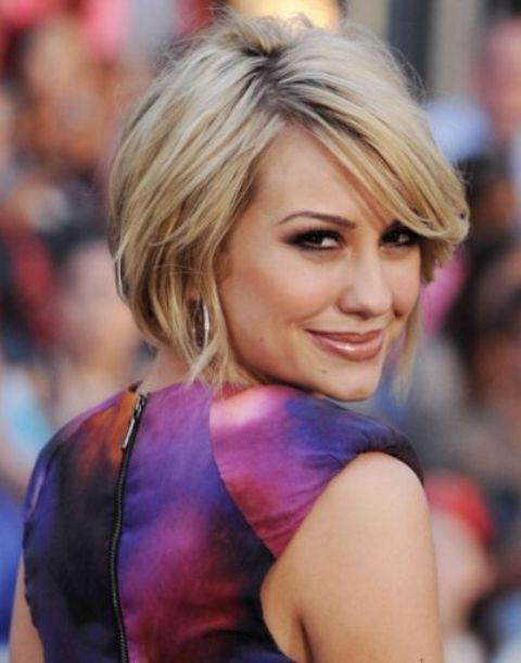 a short bob haircut with layers, side bangs and blonde balayage is modenr classics