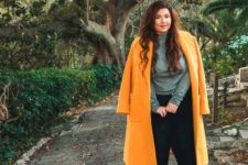 11 black pants, a grey turtleneck, nude heels and a sunny yellow coat for a bright touch