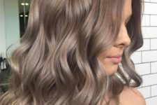 11 ombre wavy locks from rich brown to ashy brown is a trendy modern idea to try