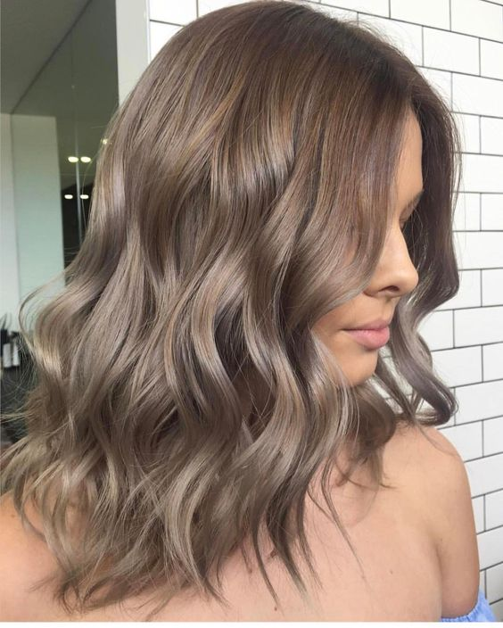 ombre wavy locks from rich brown to ashy brown is a trendy modern idea to try