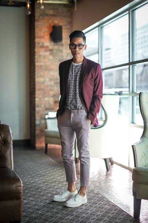 a dapper outfit with cropped grey pants, a printed tee, white shoes and a plum-colored jacket
