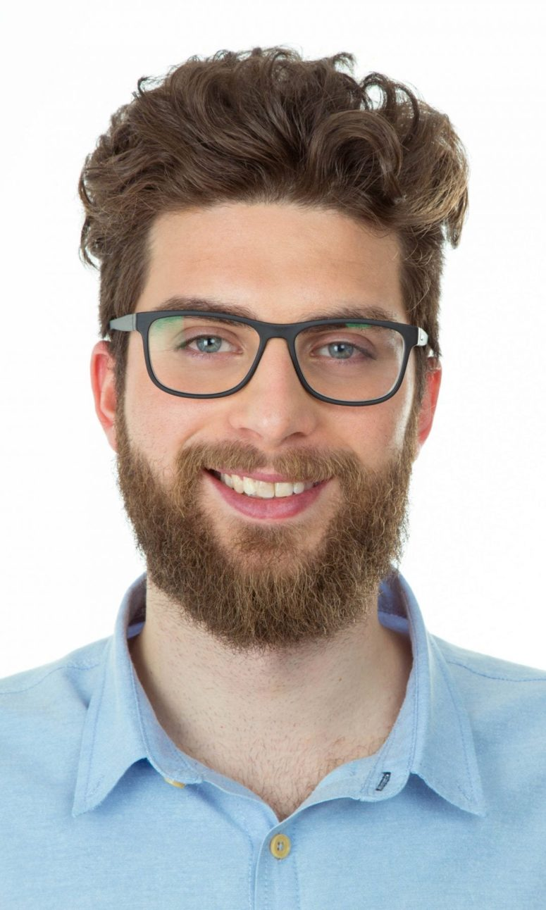 a medium curly quiff with extra volume is a fresh take on classics suitable for business environments