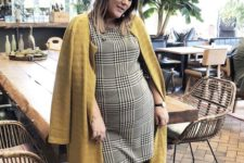 12 a plaid over the knee dress, a mustard coat, black tall boots to wear right now