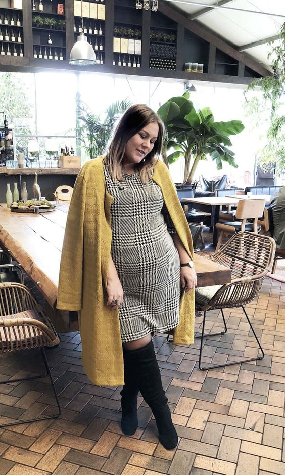 a plaid over the knee dress, a mustard coat, black tall boots to wear right now