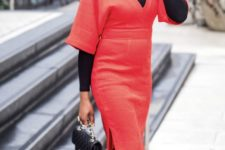12 a red midi dress worn with a black turtleneck, black tights, boots and a black bag