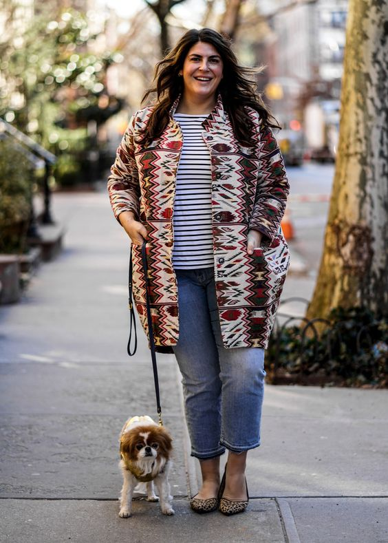 a striped top, blue cropped straight jeans, a bold printed coat and leopard flats for everyday casual