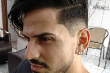 12 a super stylish long comb over plus a mid fade cut and a beard makes up a very trendy look