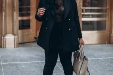 12 black skinnies, a black top, black heeled sandals and a neutral bag plus a short black coat