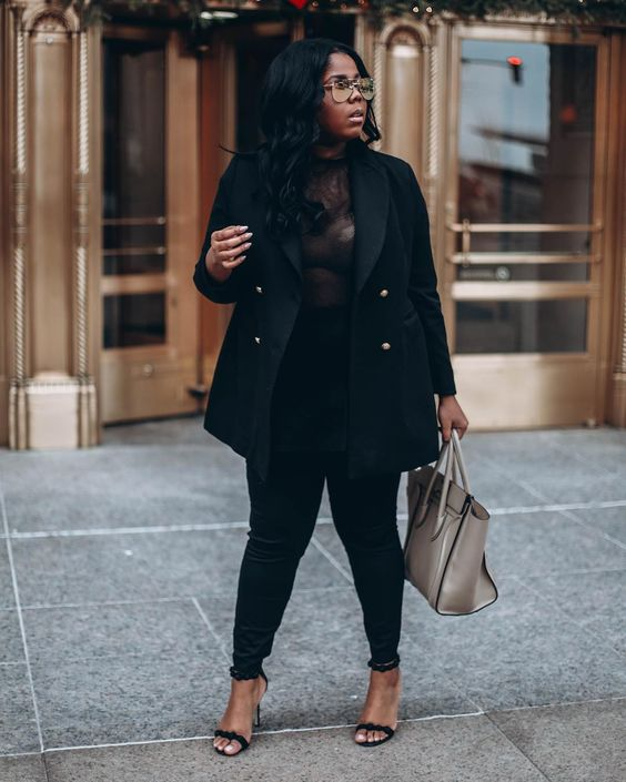 black skinnies, a black top, black heeled sandals and a neutral bag plus a short black coat