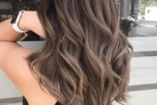 12 rich brown hair with ashy brown balayage and waves looks luxurious and stylish