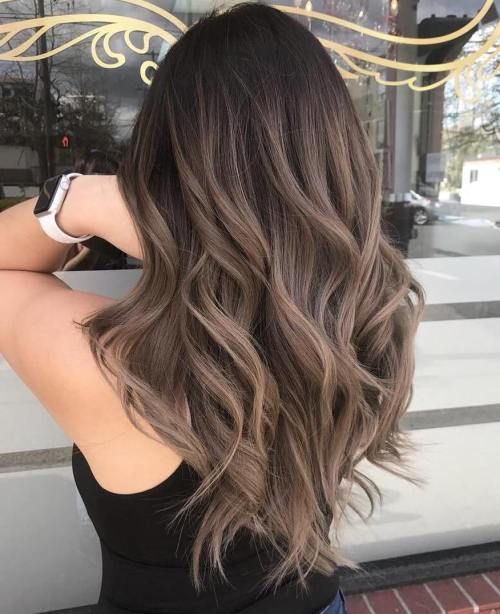 rich brown hair with ashy brown balayage and waves looks luxurious and stylish