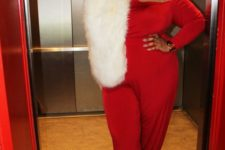 13 a breathtaking look with a red jumpsuit, a white fur stole and black lace up shoes