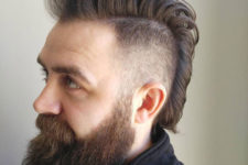 13 a long mohawk hairstyle with a fade and a long beard is a stylish and hipster idea