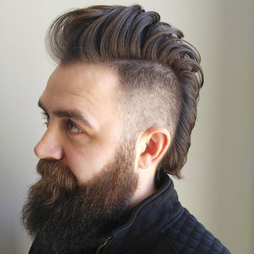 a long mohawk hairstyle with a fade and a long beard is a stylish and hipster idea