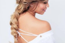 13 a messy dimensional long braid with a messy top and bangs brings romantic vibes