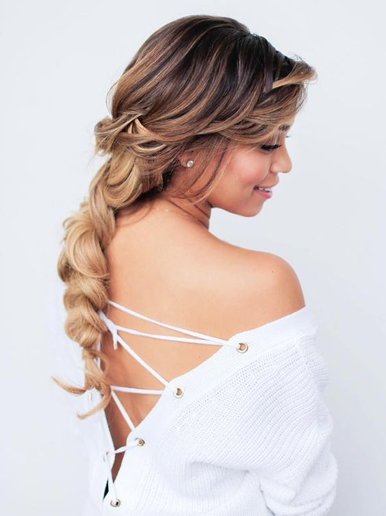 a messy dimensional long braid with a messy top and bangs brings romantic vibes