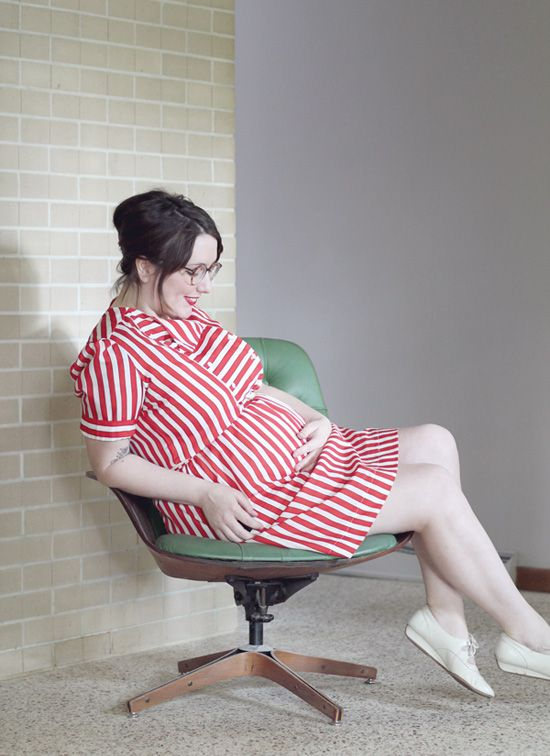 a red striped knee dress with short sleeves and white flat shoes plus a red lip