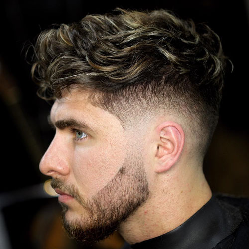 deep curly top and a mid fade looks well-groomed and very catchy