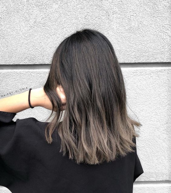 rich brown long bob with an ombre effect to ashy brown is a bold and modern option
