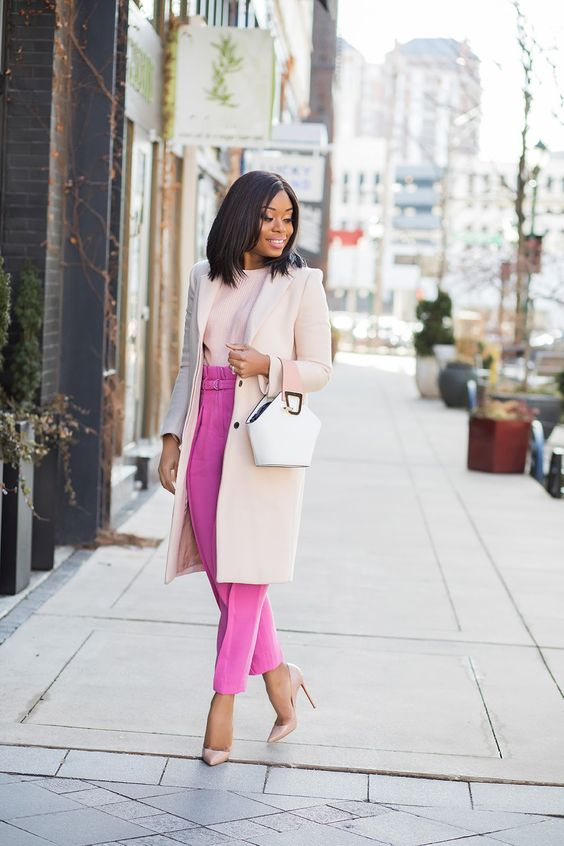 a business outfit done in pastels and pink, with bright pants and blush elements plus a white bag