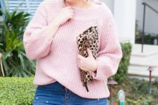 14 a casual and tender look with a blush one shoulder sweater, pearly denim, a leopard clutch