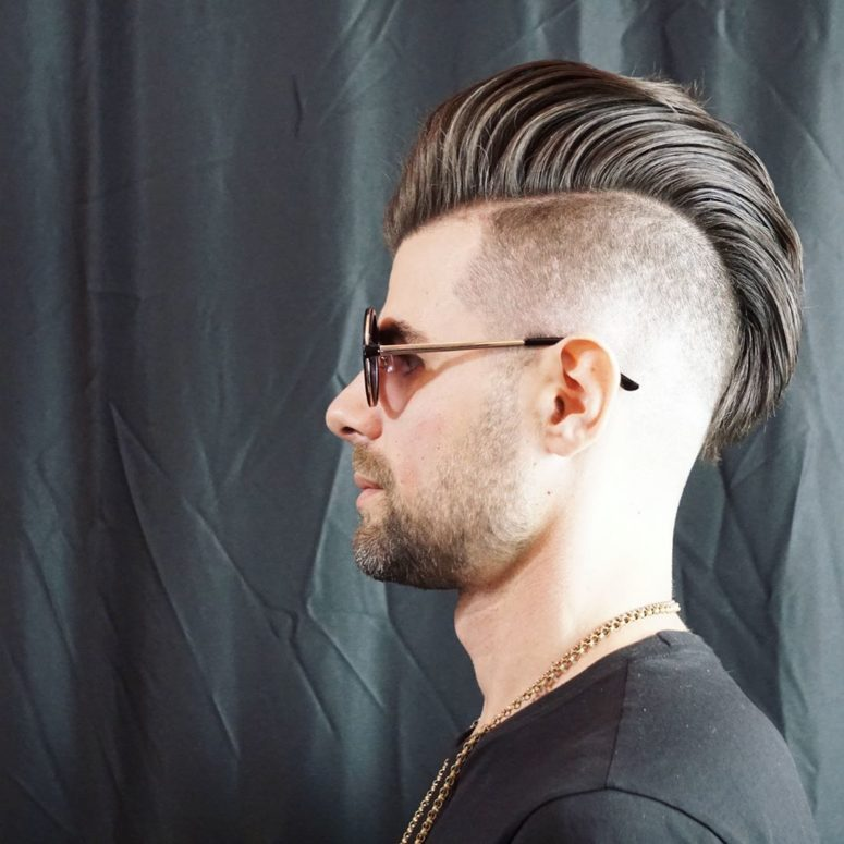 a mohawk hairstyle with a few inches of hair above the neckline and and long hair up