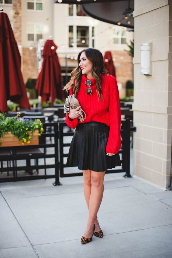 a pleated over the knee black skirt, a red sweater, leopard shoes and a clutch for a more casual feel