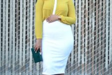 14 a white knee dress, a yellow cropped shirt over it, white strappy heels and a teal clutch