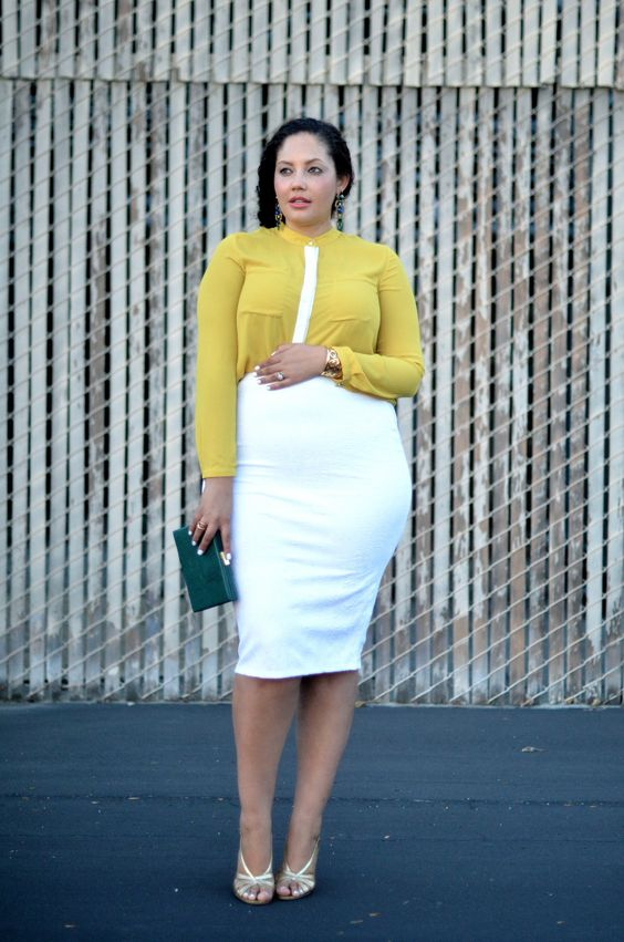 a white knee dress, a yellow cropped shirt over it, white strappy heels and a teal clutch