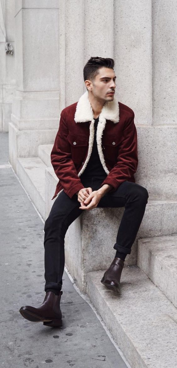 black jeans and a t-shirt, plum-colored boots and a burgundy coat with white fur for a casual look