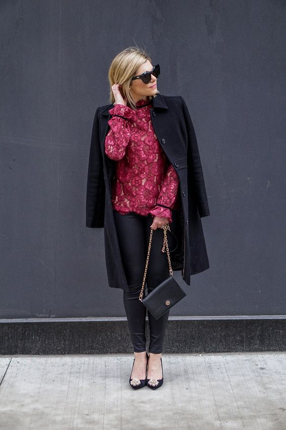 a cool look with black leather pants, black embellished shoes, a red floral blouse and a black coat