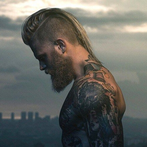 a slick mohawk haircut with a taper fade and can be cut shorter when you want it