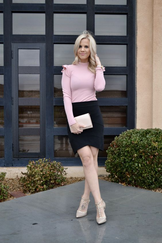 a tender look with a black asymmetrical skirt, a pink long sleeve top with ruffled sleeves and nude spiked shoes