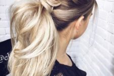 15 a voluminous high ponytail with several braids on top and with wavy textural hair