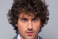 15 curls take center stage in this haircut flowing downward to give this style a sense of motion