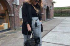 15 grey plaid pants, a black turtleneck, black sock boots, a black short coat and a studded bag