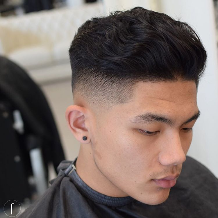 slicked back waves and a mid fade feature a cool textural top and looks classic yet modern