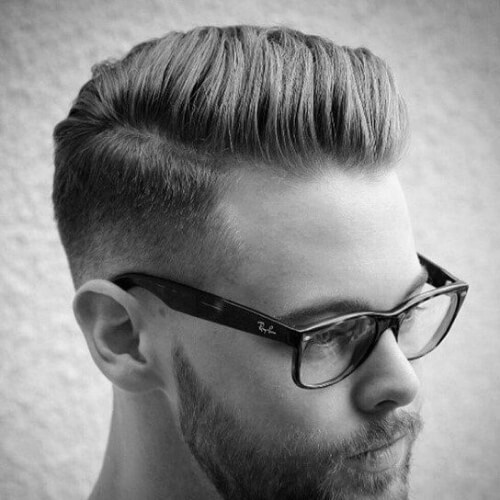 such a retro haircut with a mid fade is a modern version of classics that fits a hipster look