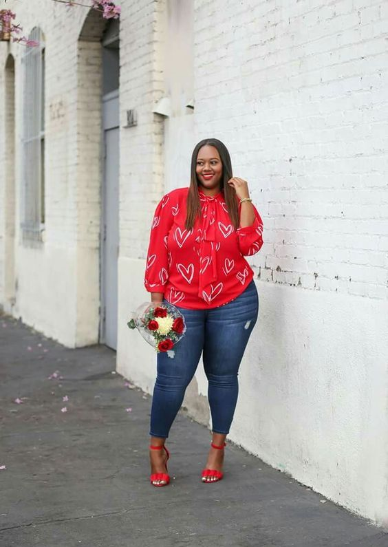 a cool and casual Valentine's Day look with a red heart printed top, blue skinnies and red heels