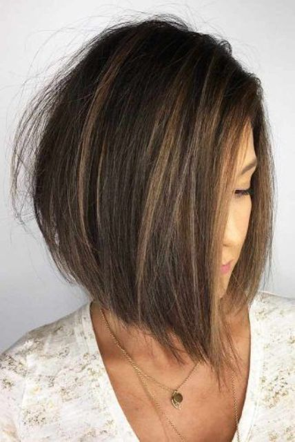 a stylish angled short bob with some highlights is a chic idea especially if you add a bit of texture