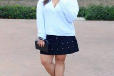 16 a white long sleeve top with a deep neckline, a black rhinestone over the knee skirt and black suede sock boots