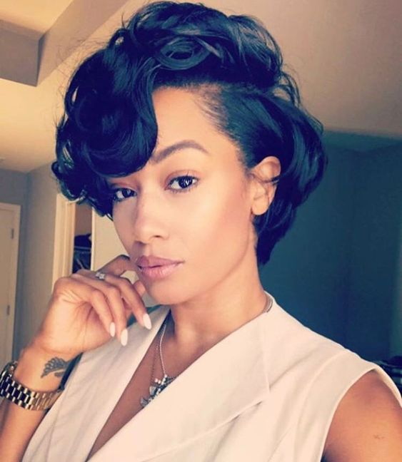 an elegant curly short bob done with a retro feel looks very elegant and stylish
