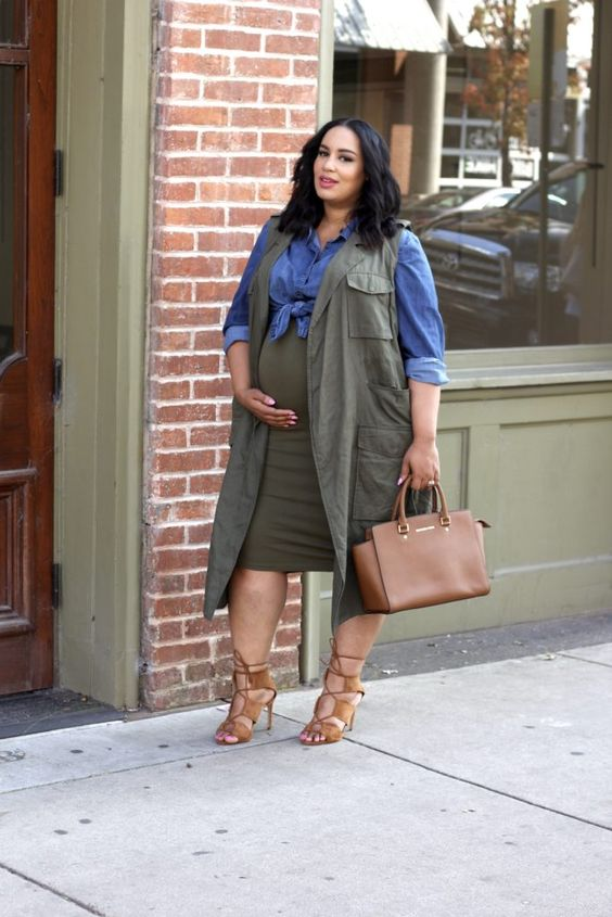 an olive pencil skirt, a chambray shirt, an olive green long vest, a brown bag and strappy heels
