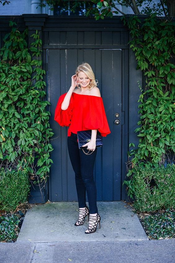 black skinnies, a red off the shoulder top, strappy high heels for a statement look