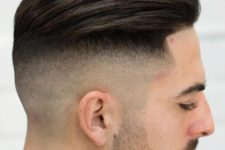 16 high skin fade with a line up is a modern and stylish idea to rock if you love longer hair