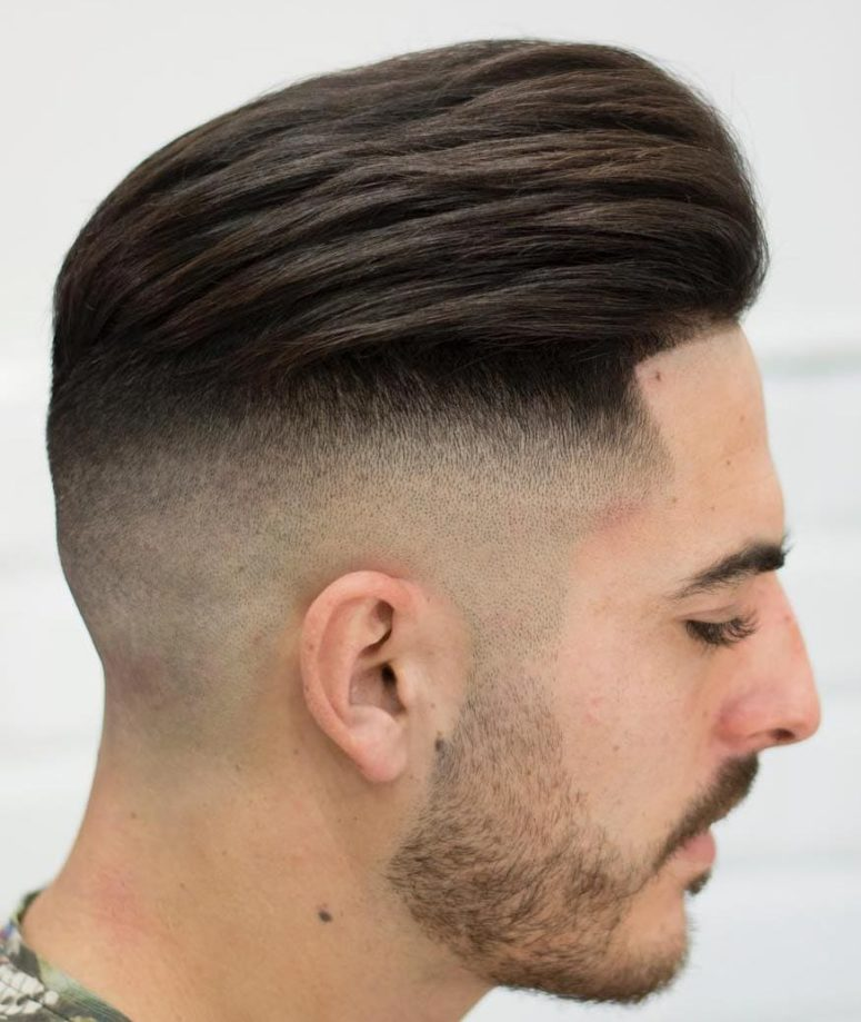 high skin fade with a line up is a modern and stylish idea to rock if you love longer hair