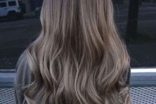 16 very long and wavy brown hair with ashy brown balayage will give you an edgy look