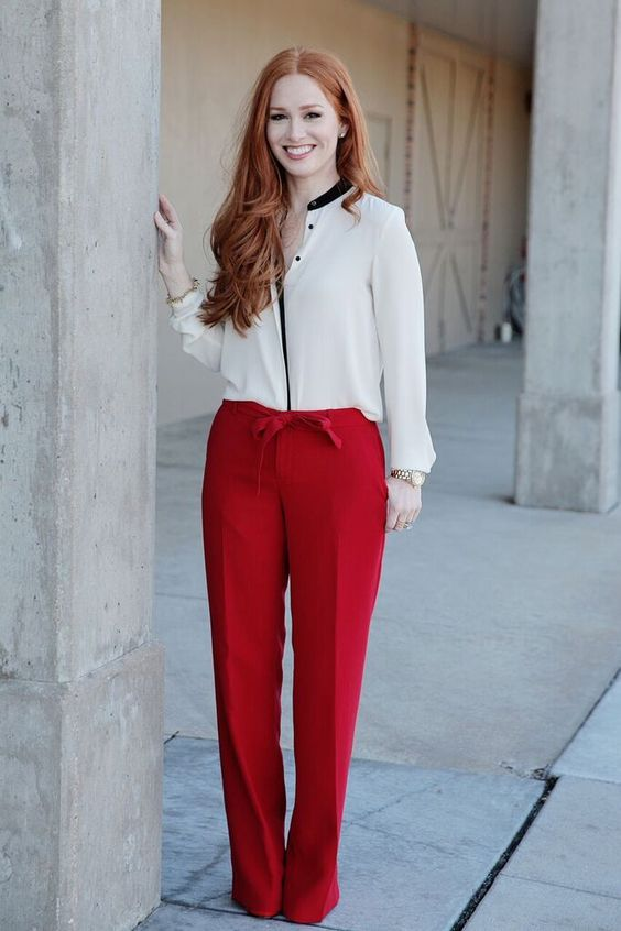 wideleg red pants, a white blouse with black detailing are perfect for work and proper for a date